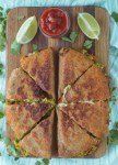 overhead shot of chorizo and avocado quesadillas on cutting board