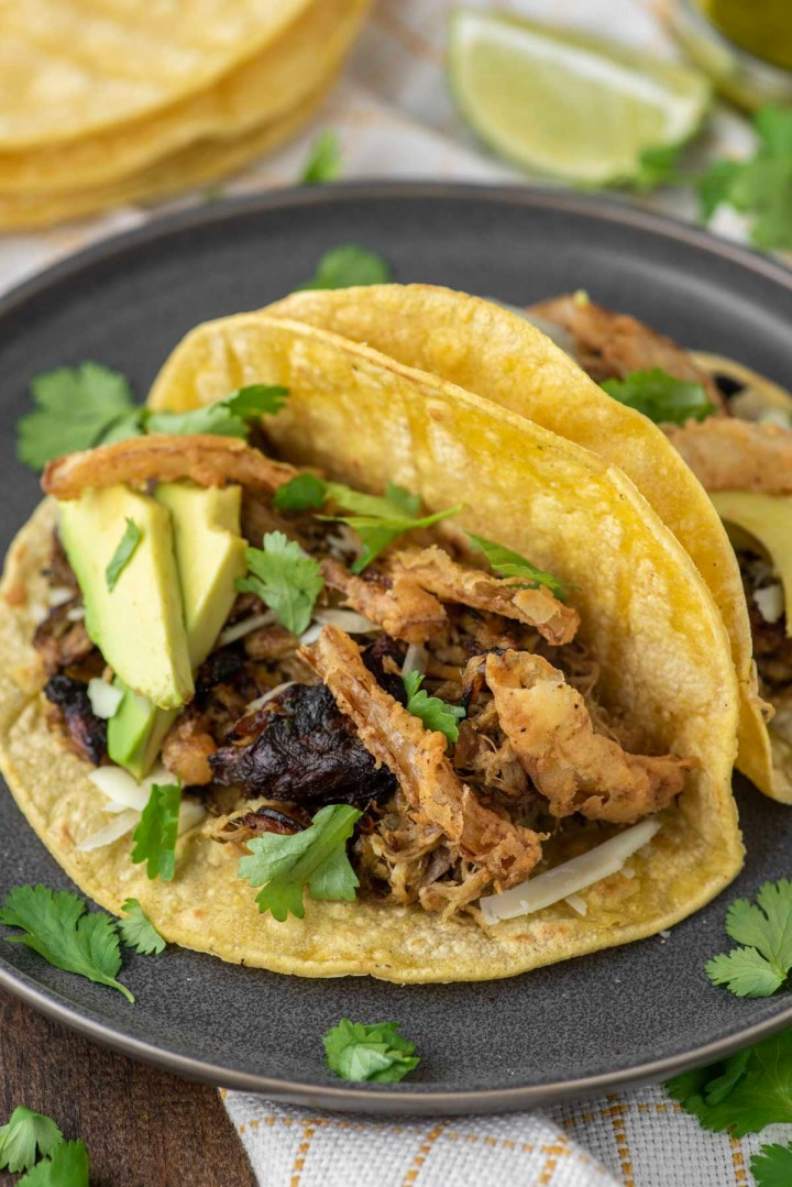 pork tacos on slate grey plate