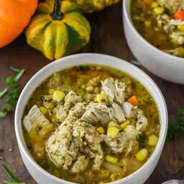 close-up of turkey stuffing dumplings soup in two orange bowls