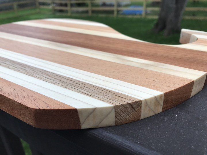 side view of whale cutting board on rail