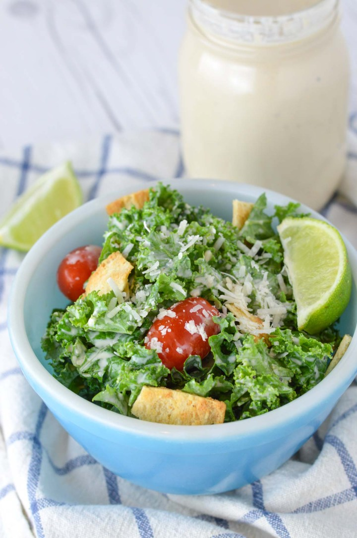 close-up of healthy kale caesar salad in blue bowl