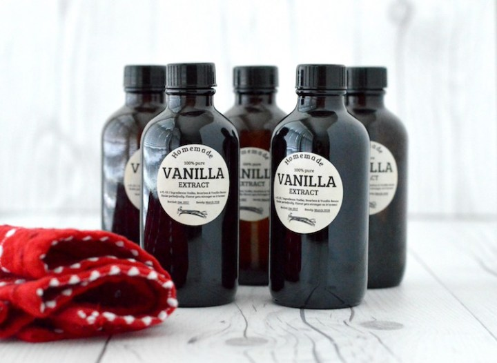 close-up of 5 bottles of homemade vanilla extract
