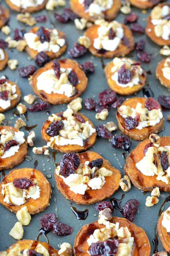sweet potato rounds with goat cheese on baking sheet