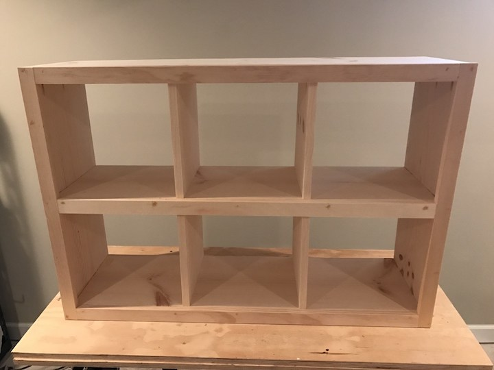 trim glued and nailed to 6 cube bookshelf