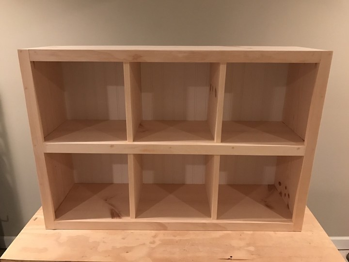 wainscot panel attached to back of 6 cube bookshelf