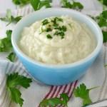 close-up of creamy garlic mashed cauliflower in blue bowl