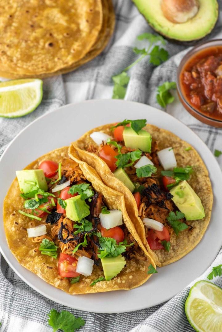 crispy chicken tacos on plate