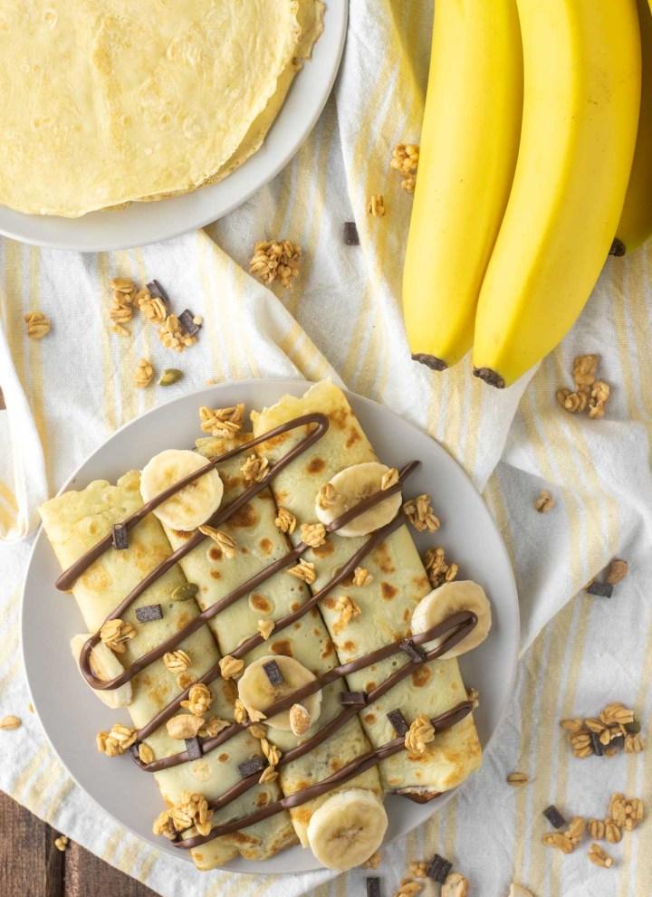 overhead shot of banana Nutella crepes on dish towel