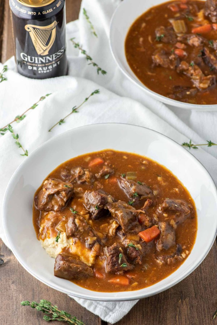 angled shot of Guinness beef stew in two white bowls