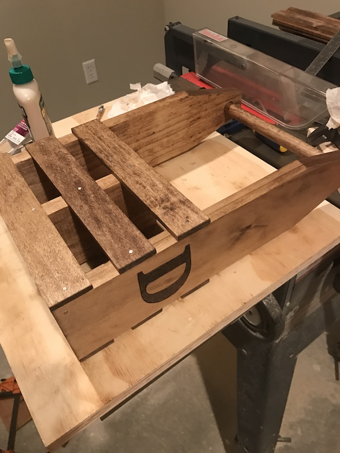 gluing and nailing side rails on wine caddy