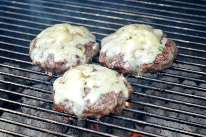bison bacon jam burger on grill