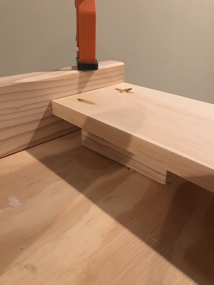 side rail being attached using kreg jig for kitchen island plan