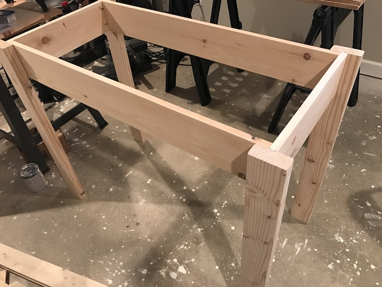 side rails being attached to legs for kitchen island plan
