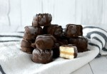 close-up of stacked chocolate peanut butter banana bites on kitchen towel