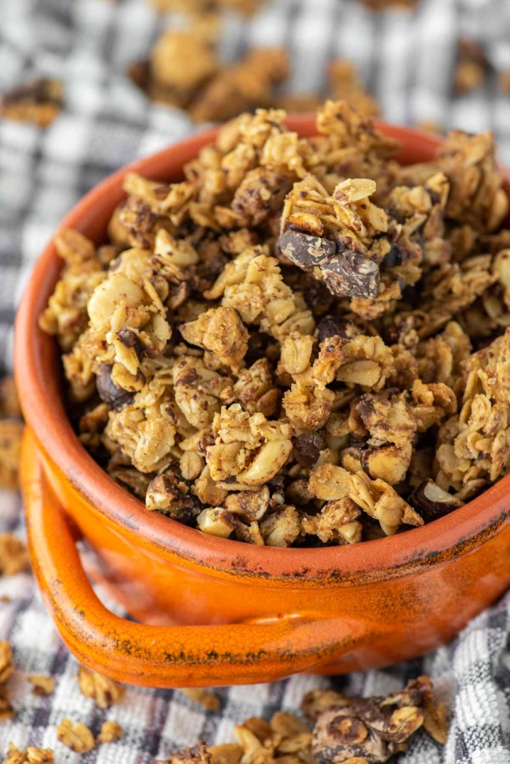 dark chocolate hazelnut granola in orange bowl