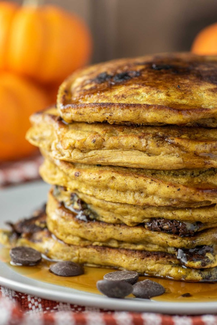 close-up of stacked pumpkin chocolate chip pancakes on plate