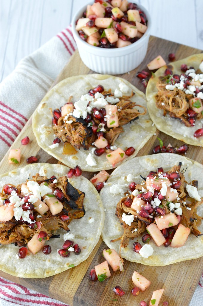 close-up of cider beer braised pork tacos on cutting board