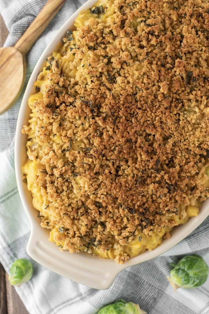 overlay of baked butternut squash mac and cheese in green baking dish