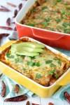 close-up of veggie black bean enchiladas in yellow baking dish