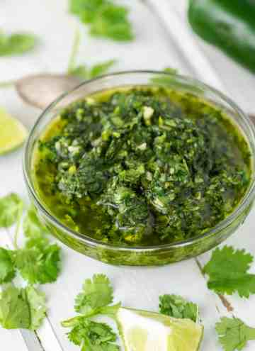 close-up of cilantro chimichurri sauce in white ramekin