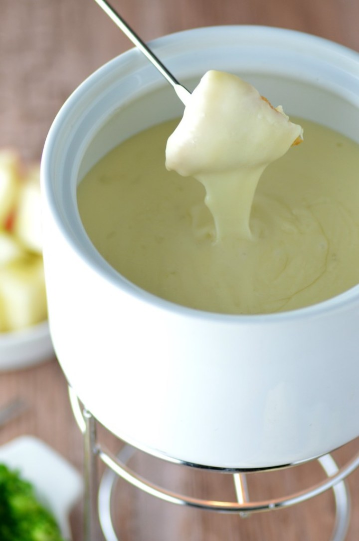 bread dipping in cheese fondue