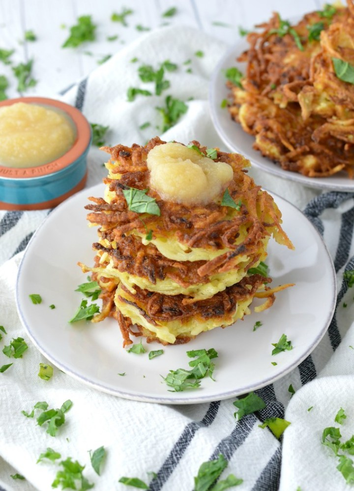 close-up of stacked classic potato latkes on white plate