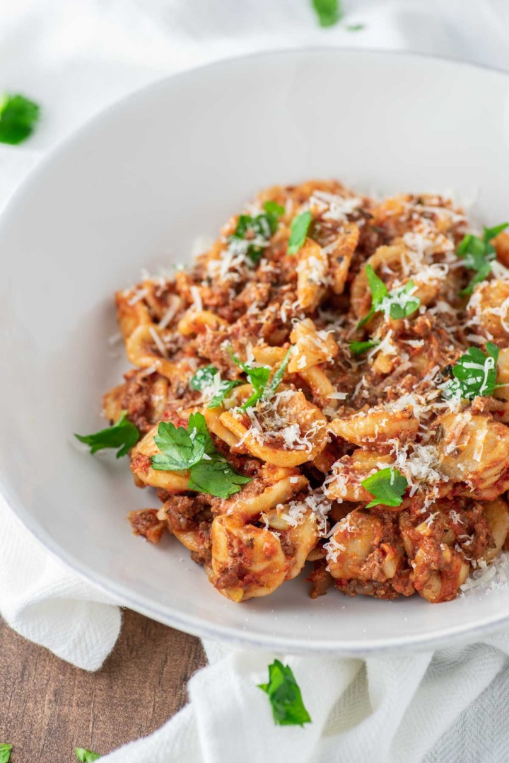 close-up of weeknight bolognese in white bowl