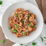 overhead shot of weeknight bolognese in white bowl
