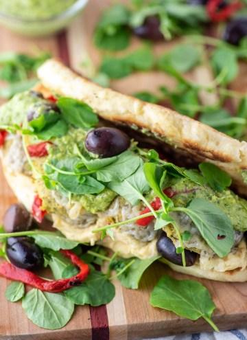 Greek falafel sandwich on cutting board