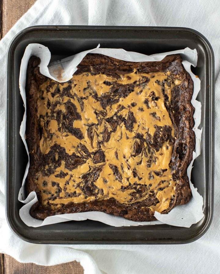 overhead shot of vegan gluten-free peanut butter swirl brownies in square pan