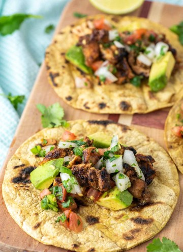 grilled chicken tacos on cutting board