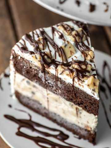 slice of cookie dough ice cream cake on slate plate