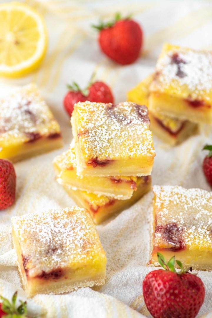 strawberry lemon bars on dish towel
