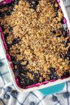 overhead shot of blueberry crisp in baking dish