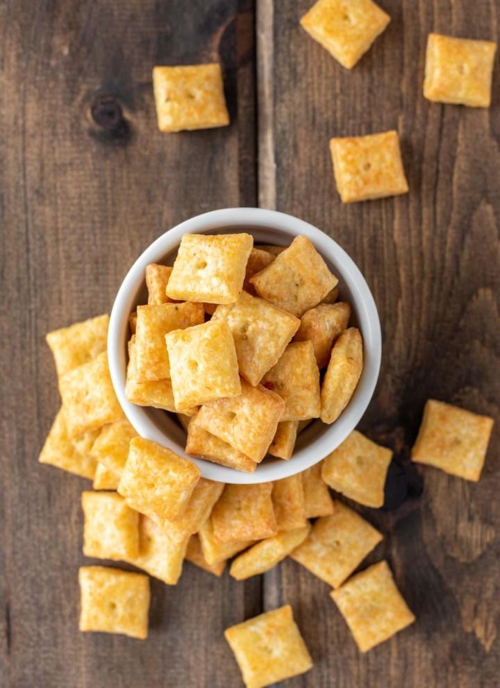 overhead shot of homemade cheese crackers in white ramekin