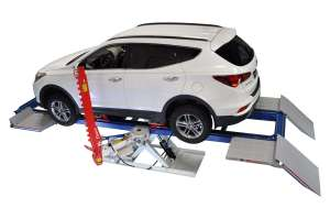 Auto Frame Straightening Tools From Above, With Vehicle on Bench