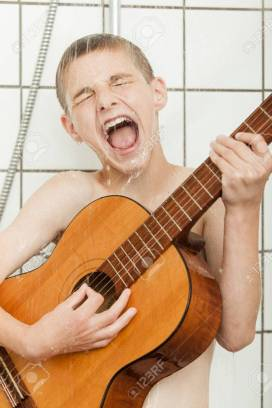 81158692-funny-portrait-of-singing-male-child-playing-guitar-in-shower-stall-dripping-with-water.jpg