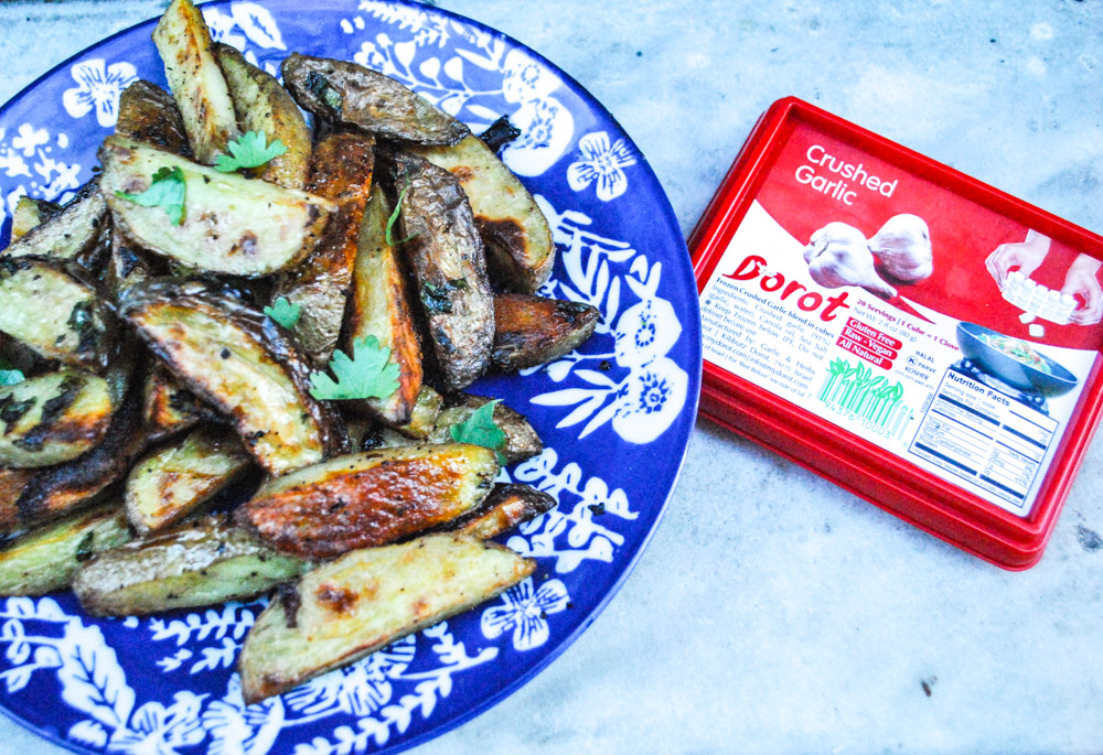 Lifestyle blogger Jenny Meassick of the weekend blog Chocolate and Lace shares her recipe for Garlic Potato Wedges featuring Dorot Fresh Garlic and Herbs.