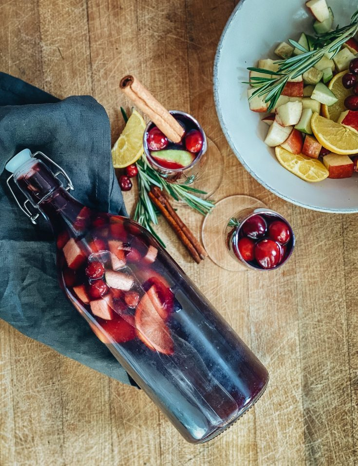 Chocolate and Lace shares her holiday cocktail recipe for the best holiday sangria.