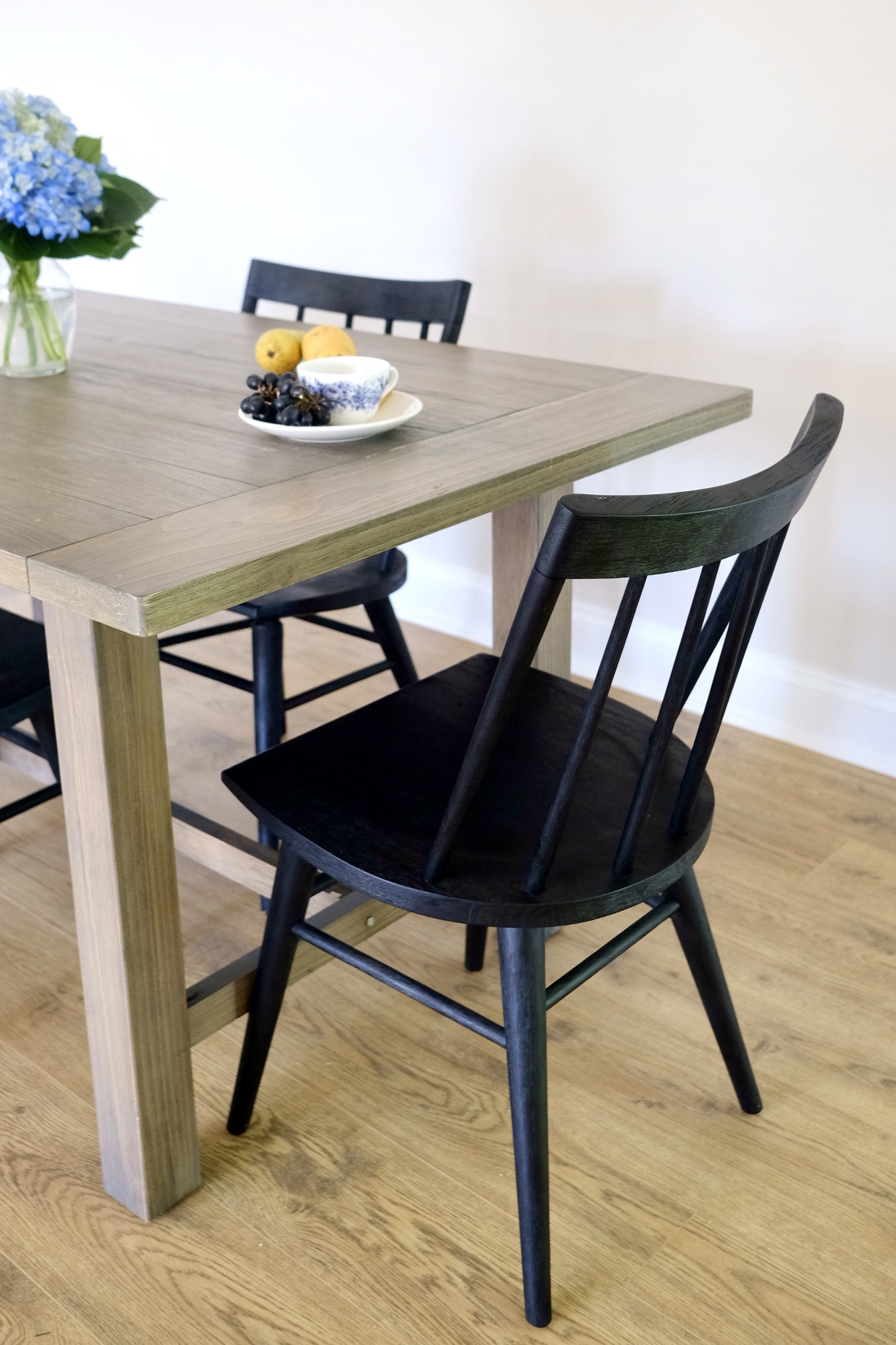 Lifestyle Blogger Chocolate and Lace shares her farmhouse style dining table and chairs