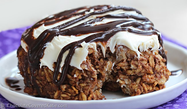 Wholesome chocolate cheesecake baked oatmeal that tastes like dessert for breakfast! Recipe here: http://chocolatecoveredkatie.com/2015/03/15/single-serving-chocolate-cheesecake-brownie-baked-oatmeal/