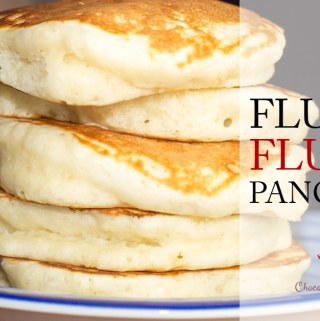 Five super fluffy pancakes stacked high on a blue plate.