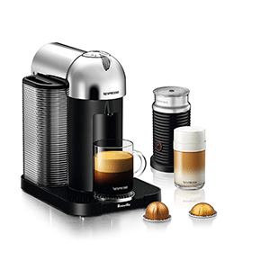 Nespresso Virtuoline with Aeroccino Milk Frother and a latte next to it.