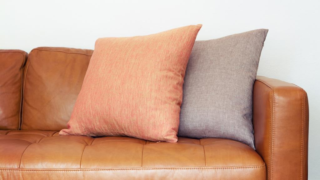 leather sofas cheap prices sofascore live scores fake vs real couches - how to tell the difference