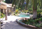 New permeable pavers edged with a seatwall invite to stroll to poolside