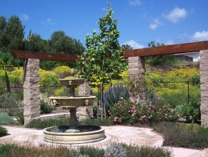 A three-tiered fountain decorates the backyard
