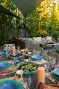 A double layer of pale green sails provides cool shade to a new dining and lounging area.