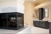 Double Sided Fireplace in Master Bathroom