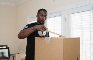 mover packing a box ready to be relocated to florida