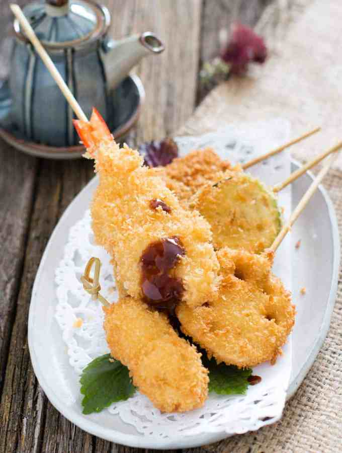 skewered prawn and other ingredients panko crumbed and deep fried on a plate